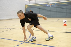 PFC Bruce Case, with U.S. Army Europe's Charlie Company, Brigade Support Battalion, 173rd Airborne Brigade Combat Team, improves his agility with cross-step drills during Mission Essential Fitness training in Bamberg, 21 April 2011.(U.S. Army Europe photo by Mark Ray)